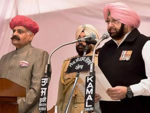Punjab Governor V P Singh Badnore administering oath to the new Punjab Chief Minister Amarinder Singh