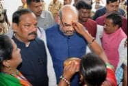 BJP President Amit Shah being welcomed by party workers