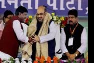 BJP President Amit Shah is presented a shawl by party leader Arjun Munda