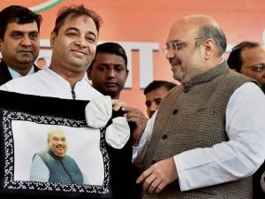 BJP workers felicitate Amit Shah on being re-elected as the party president at the party headquarters in New Delhi