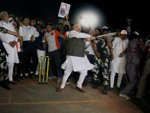 Bharatiya Janata Party (BJP) national President and President of Gujarat Cricket Association, Amit Shah plays a shot while inaugurating Karnavati Premier League(KPL) cricket tournament in Ahmedabad