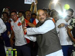 National President of BJP Amit Shah plays cricket with his supporters during inaugural function of Karnawati Premier League (KPL) night cricket tournament in Ahmedabad