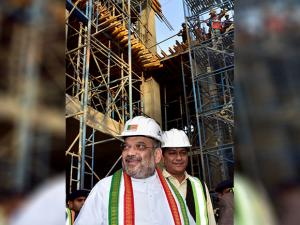 BJP president Amit Shah inspects the construction works for the new headquarters
