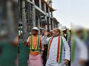 BJP president Amit Shah inspects the construction works for the new headquarters of the party