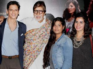 Amitabh Bachchan and Kirti Kulhari pose for photographers at a promotional event