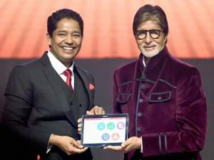 Mahesh Shetty, CMD of MD Educare and Bollywood actor Amitabh Bachchan during the launch of 'Robomate plus' mobile app in Mumbai