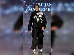 Amitabh Bachchan walks the ramp at a fashion show