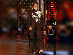 Amitabh Bachchan walks the ramp at a fashion show in Mumbai