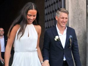 Ana Ivanovic holds hands with Bastian Schweinsteiger during their wedding