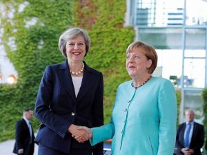 German Chancellor Angela Merkel and British Prime Minister Theresa May during a military welcoming ceremony at the chancellery in Berlin