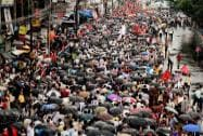 Left Front activists take part in a rally to observe Anti-Imperialist Day