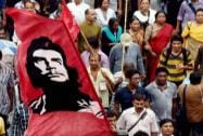 Left Front activists take part in a rally to observe anti-imperialist day in Kolkata