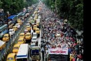 Traffic stands still as Left Front activists take part in a rally to observe Anti-Imperialist Day  in Kolkata