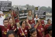 Activists participating in a protest march over lack of progress in anti-superstition campaigner Narendra Dabolkhar's murder case