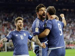 Gonzalo Higuain celebrates his goal with Lionel Messi, left, and Ezequiel Lavezzi