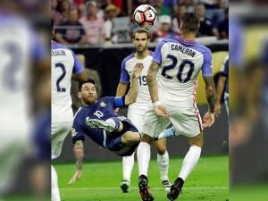 Lionel Messi (10) kicks the ball against United States defender Geoff Cameron