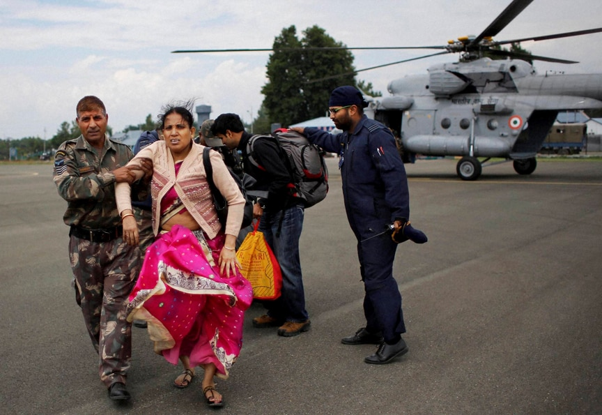 Soldiers, carry, rescued flood, victim, Air Force Station, Srinagar