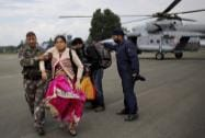 Soldiers carry a rescued flood victim at the Air Force Station  in Srinagar
