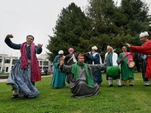 Kashmiri traditional artists perform during the two day tourism festival at Dal Lake in Srinagar