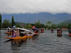 Shikarawallas ferrying tourists during the two day tourism festival at Dal Lake in Srinagar