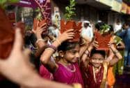 "People participate in ""Dindi"" procession on the eve of Ashadi Ekadashi in Mumbai"
