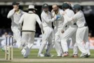 Australia's Nathan Lyon celebrates taking the wicket of England's Ian Bell