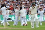 England players celebrate after Australia's Adam Voges