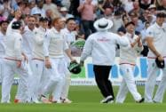 England's Ben Stokes celebrates with teammates after catching Australia's Adam Voges,