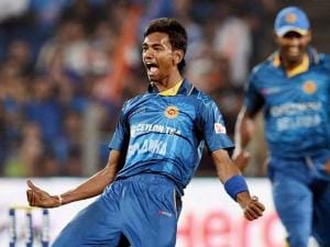 Sri Lankan bowler Dushmantha Chameera celebrates the wicket of Indian batsman Yuvraj Singh during the first T20 match in Pune