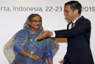 Indonesian President Joko Widodo greets Bangladeshi Prime Minister Sheikh Hasina