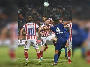 Atletico de Kolkata and Mumbai city FC players vie for the ball during ISL Semi Final