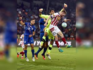 Atletico de Kolkata and Mumbai city FC players vie for the ball during ISL Semi Final match
