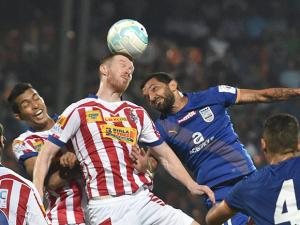 Atletico de Kolkata and Mumbai FC players vie for the ball during ISL Semi Final match