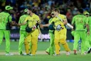 Australia's Shane Watson, centre, and teammate  shake hands with the Pakisrtan players