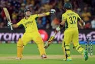 Australia's Shane Watson, left, celebrates with teammate Glenn Maxwell