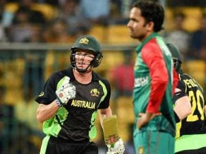 Australian batsman James Faulkner celebrates after hitting the winning shot during the ICC World T20 match between Australia and Bangladesh at Chinnaswamy Stadium