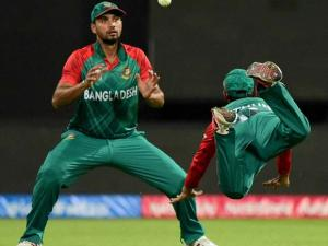 Bangladesh fielder M Mithun dives to take the catch of Shane Watson  during the ICC World T20 match between Australia and Bangladesh at Chinnaswamy Stadium