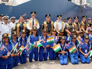 The crew of Australian Border Force's largest patrol vessel 'Ocean Shield' poses with students of a local private school