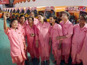 Women who were distributed 25 auto rickshaws by Shiv Sena chief Uddhav Thackeray, click selfie with the vehicles, in Thane