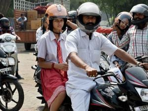 Students during an awareness campaign on wearing helmet