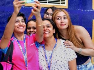 Jwala Gutta and Ashwini Ponnappa taking selfie with fans at the Badminton Asia Team Championships in Hyderabad