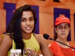 Rio Olympics silver medalist, World no. 5,  P V Sindhu speaks as World no. 4, Carolina Marin of Spain looks on during the press conference