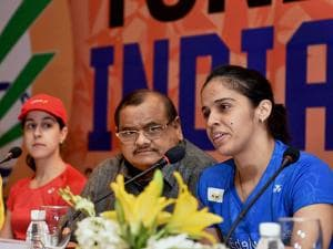 Star badminton player Saina Nehwal speaks as BAI President, Akhilesh Das Gupta