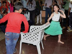 Bollywood child artist (Bajrangi Bhaijaan fame Munni) Harshaali Malhotra playing musical chair during the inauguration of a Summer Camp at a School in Bhopal