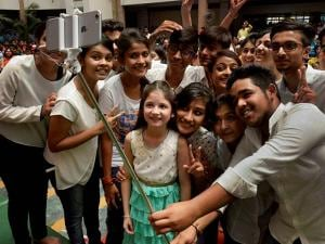 Students take selfie with child artist (Bajrangi Bhaijaan fame Munni) Harshaali Malhotra during the inauguration of a Summer Camp at a School in Bhopal