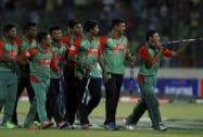 Bangladesh's players celebrate their win over India