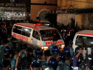 Bangladeshi security personnel cordon an ambulance leaving central jail, carrying the body of Jamaat-e-Islami party chief Motiur Rahman Nizami, after he was executed in Dhaka, Bangladesh