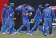 India's players walk back to the pavilion