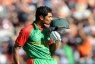 Bangladesh's Mahmudullah kisses his helmet as he celebrates