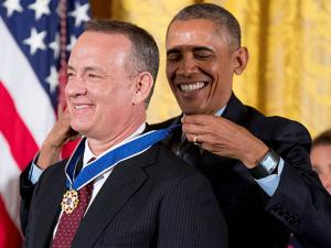 President Barack Obama presents the Presidential Medal of Freedom to actor Tom Hanks